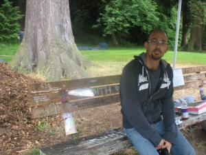 "Sitting on ""Kurt Cobain's bench"" next to his last Seattle home"